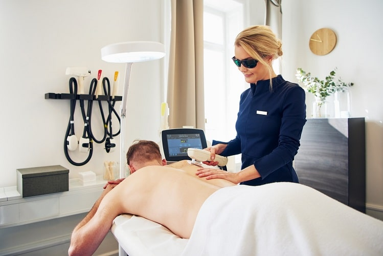 beauty-technician-performing-laser-hair-removal-LRMUXDP-min
